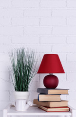Interior design with lamp, plant, ceramic watering pot and