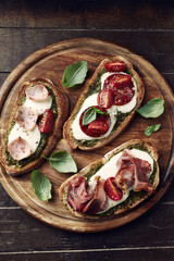 Crostinis on a wooden chopping board