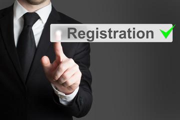 businessman pressing button registration