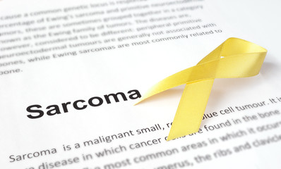 Paper with sarcoma   and yellow ribbon.