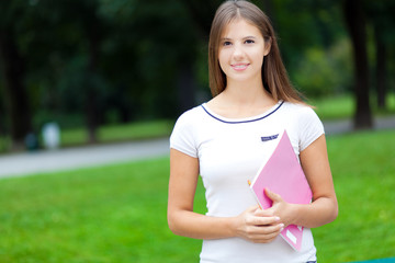 Smiling female student at the park
