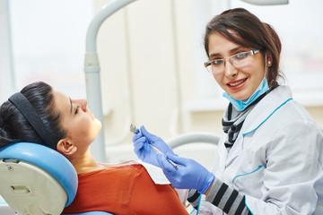 female asian dentist doctor at work