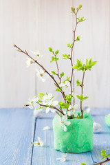 Spring blooming twigs wooden table