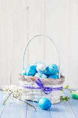 Spring basket Easter eggs blue tone