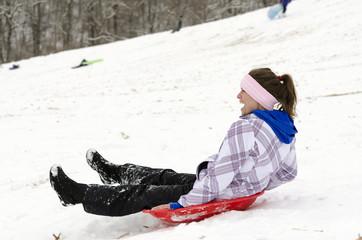 Sledding on winter hill