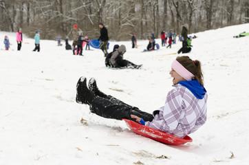 sledding woman winter time