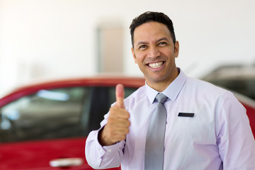 car salesman thumb up
