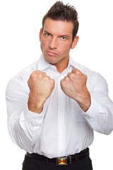 Angry handsome man in white shirt shows his fist
