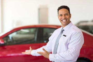 vehicle salesman presenting new cars
