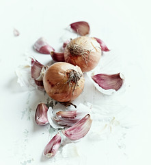 Garlic cloves and onions