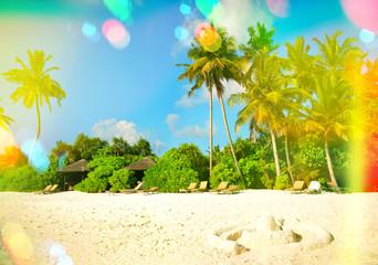 Paradise island sand beach. Blue sky with light leaks and lens f