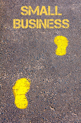 Yellow footsteps on sidewalk towards Small Business message