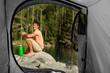 Conceptual photo of camping man shot through the tent