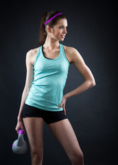 Young woman kettlebell workout