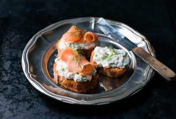 Canapes with smoked salmon and cream cheese spread