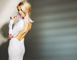Stunning young woman wearing white gown