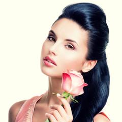 Sensual beautiful woman with pink rose.