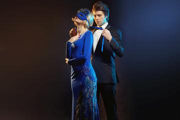 elegant man tying the blue mask