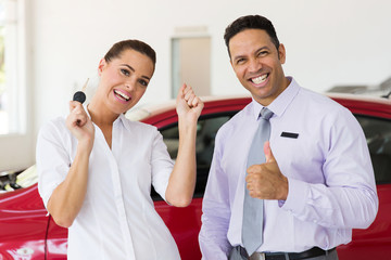 woman just bought a new car from dealership