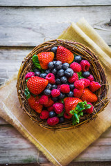 Berries on wooden background