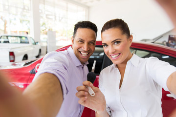 couple taking selfie together at dealership