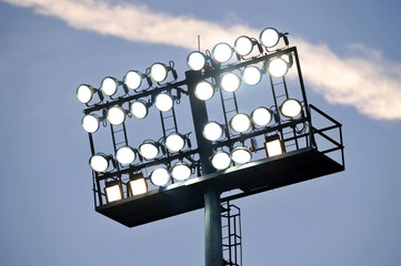Stadium lights at sunset