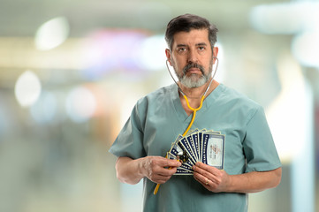 Hispanic doctor holding Social Security Cards and Stethoscope