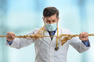 Doctor Holding Frayer Rope