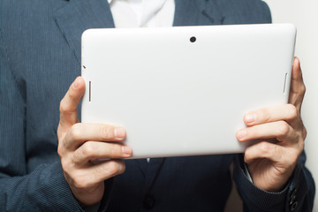 Close up business man holding tablet pc