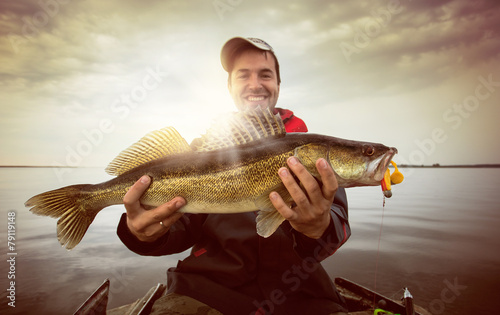 Tuinposter Vissen Happy angler with zander fishing trophy
