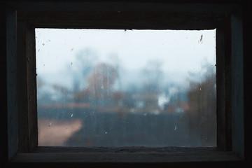Rain drops on glass in frame