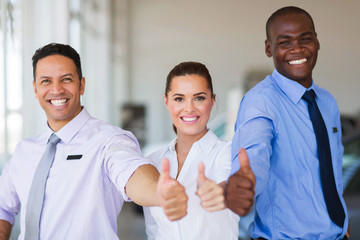 vehicle sales team giving thumbs up