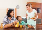 eenager eating breakfast in home interior