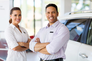 vehicle sales staff with arms crossed