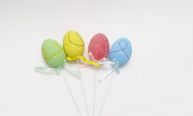Closeup view of colorful Easter eggs on light grey background