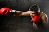 furious man training boxing on gym throwing vicious punch poster