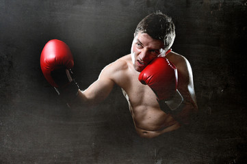 furious man training boxing on gym throwing vicious punch