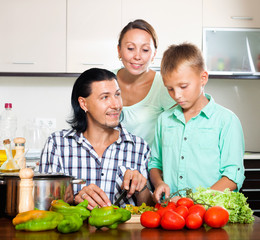 Happy family cooking food