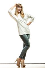 blonde fashion woman in white shirt denim pants