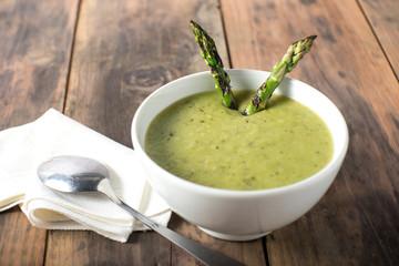 White bowl of cream asparagus soup