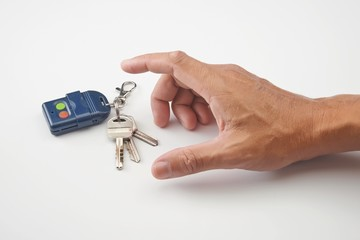 A hand want to get remote control and keys