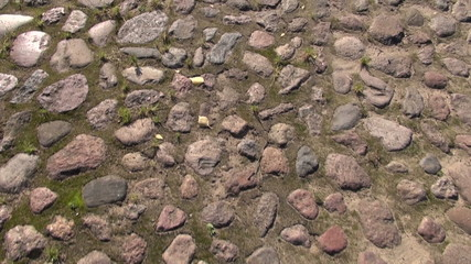 walking on old cobble-stone road