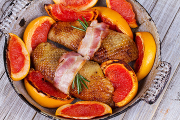 Roasted duck breast fillet with bacon and grapefruit
