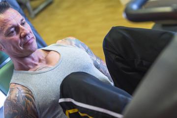 man making leg press - workout routine .