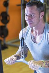 man making pulley push down - workout routine .