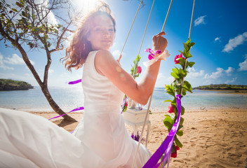 background of bride ride on a swing