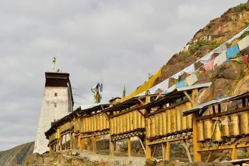 Prayer wheels around monastery in Shigatse, Tibet