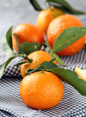 ripe organic fruit tangerines with green leaves