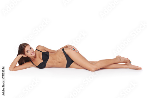 Leinwandbild Motiv Woman lying down in lingerie