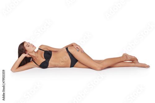 Woman lying down in lingerie - 79133359